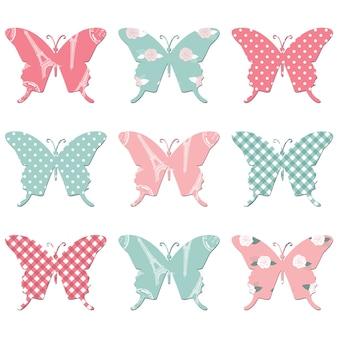 Motyle tekstylne w pastelowych kolorach różowym i niebieskim.