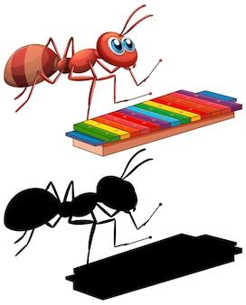 Mrówka z instrumentem muzycznym ksylofon