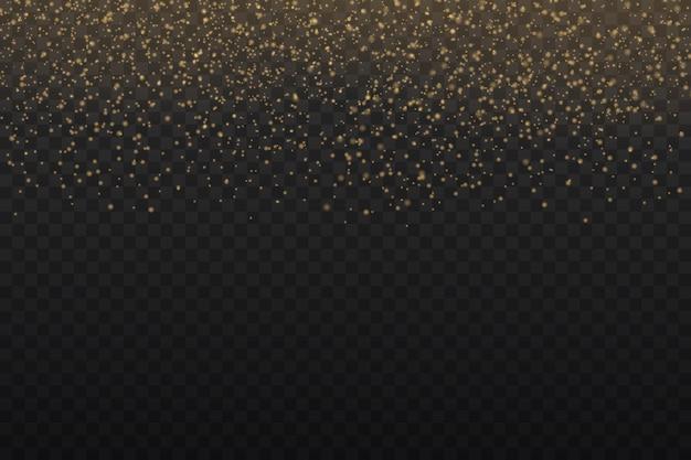 Musujące złote magiczne cząsteczki pyłu na przezroczystym tle.