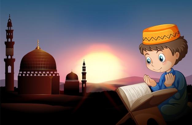 Muzułmańska chłopiec modli się przy meczetem