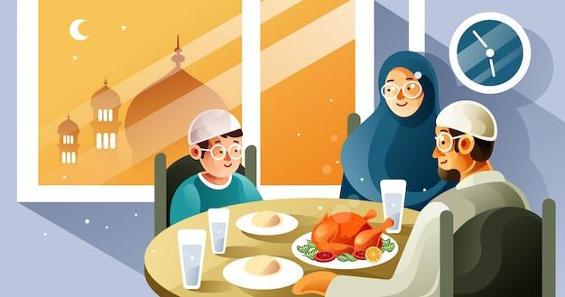 Muzułmańska rodzina spożywa posiłek iftar w ramadanie