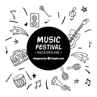 Muzyczny festiwalu tło z instrumentami w ręka rysującym stylu