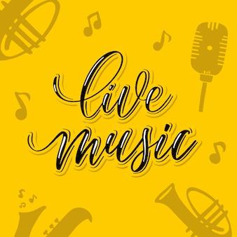 Muzyka na żywo - ręczna karta z napisem.