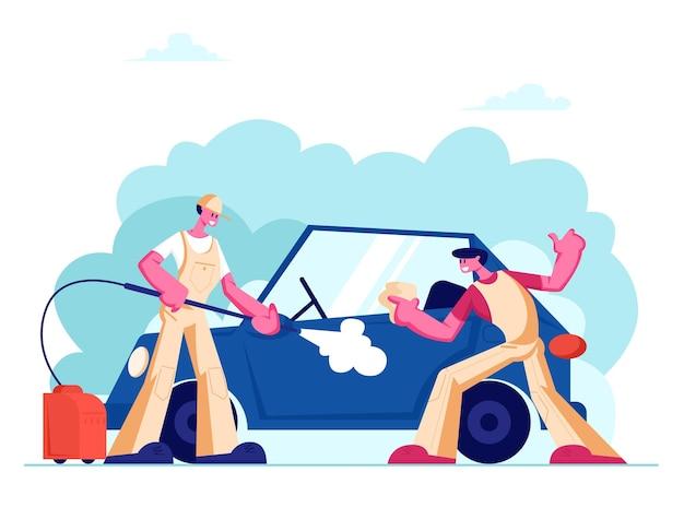Myjnia samochodowa z kilkoma pracownikami w mundurach