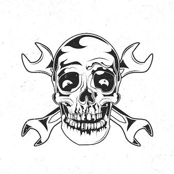 Na białym tle emblemat z ilustracją czaszki mechanika