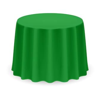 Na białym tle pusty okrągły stół z obrusem w kolorze zielonym na białym tle