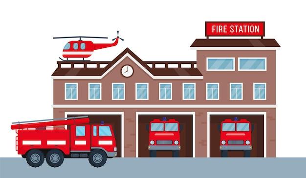 Na zewnątrz budynku straży pożarnej z wozami strażackimi i helikopterem. fasada domu straży pożarnej