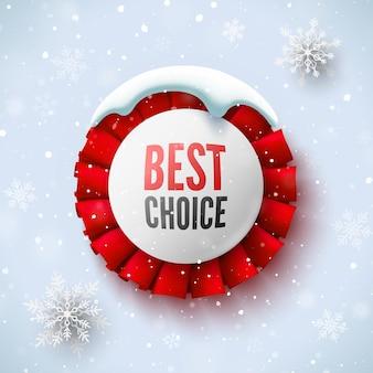 Najlepszy wybór baner sprzedaży z czerwoną wstążką czapka śnieżna i płatki śniegu okrągła odznaka ilustracja wektorowa