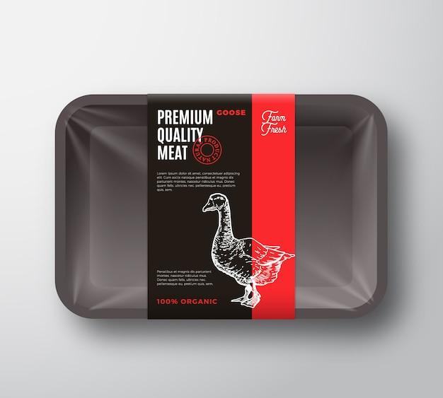 Najwyższej jakości opakowanie z mięsem gęsim i pasek z etykietą.