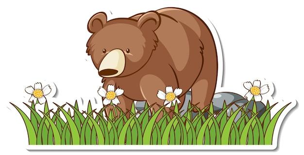 Naklejka z niedźwiedziem grizzly stojącym na polu trawy