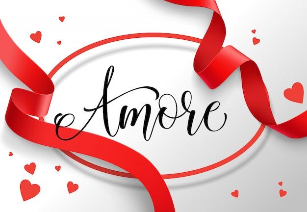 Napis amore w owalnej ramie z czerwoną wstążką