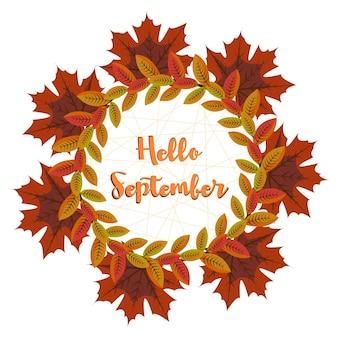 Napis hello september na tle okrągłej ramki jesiennych liści i pajęczyny