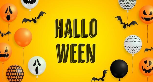 Napis na halloween, nietoperze, balony duchów i dyni