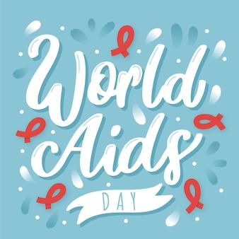Napis na wydarzeniu światowego dnia aids z czerwonymi wstążkami
