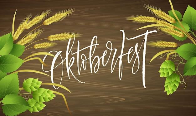 Napis oktoberfest z liśćmi i gałązkami pszenicy