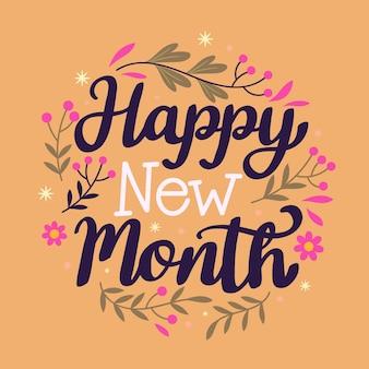 """Napis """"szczęśliwego nowego miesiąca"""" z ręcznie rysowanymi elementami"""