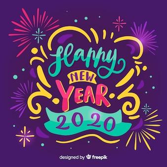 Napis szczęśliwego nowego roku 2020 z fajerwerkami