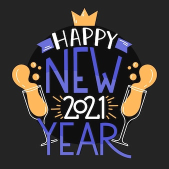Napis szczęśliwego nowego roku 2021 z kieliszkami do szampana