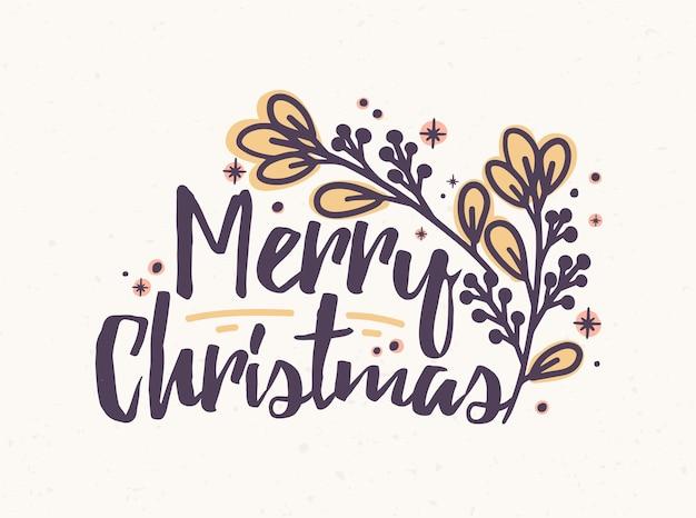 Napis wesołych świąt napisany elegancką kursywą kaligrafii. odręczne życzenia świąteczne ozdobione gałązką. dekoracyjna kompozycja