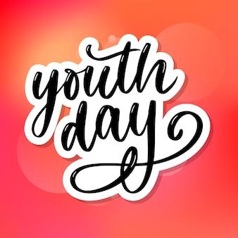 Napis z hasłem międzynarodowego dnia młodzieży żółte tło