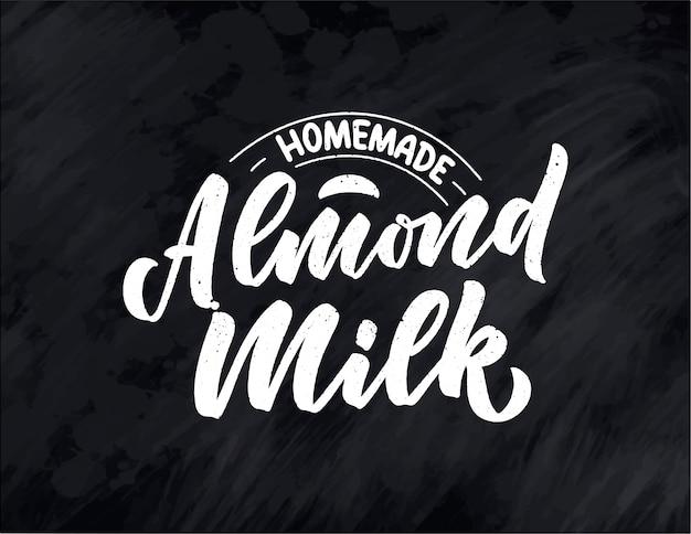 Napis z mlekiem migdałowym na baner, logo i opakowanie. odżywianie organiczne zdrowa żywność. zwrot o produkcie mlecznym.