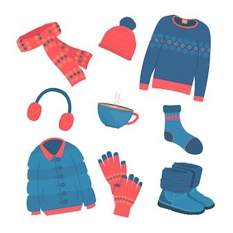 Narysowany przytulny zestaw zimowych ubrań i niezbędnych akcesoriów