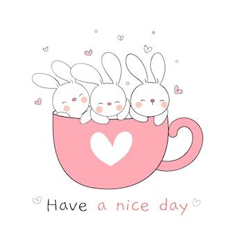 Narysuj królika śpiącego w różowej filiżance kawy na wiosnę.