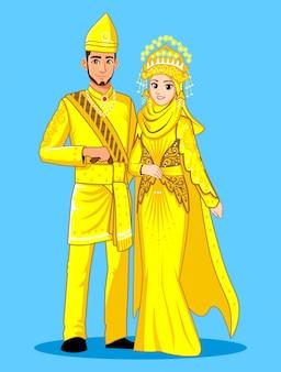 Narzeczone melayu deli w tradycyjnych żółtych i złotych ubraniach.