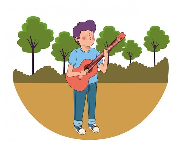 Nastolatek chłopak gra na gitarze