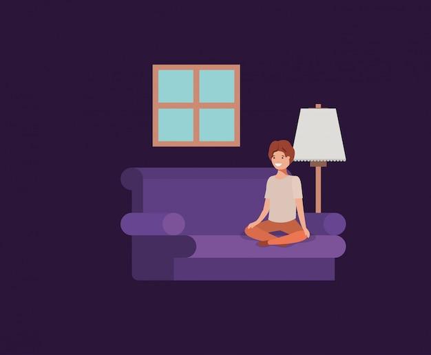 Nastolatek chłopiec sadzająca w pokoju dziennym