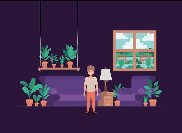Nastolatek chłopiec w pokoju dziennym