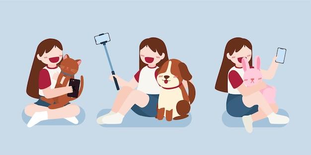 Nastolatka robi zdjęcie aparatem w telefonie komórkowym, robi selfie lub prowadzi rozmowę na żywo i wideo ze swoim zwierzakiem