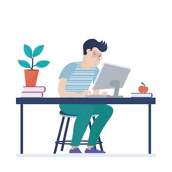 Nastoletni chłopak, dziecko w okularach pracuje na komputerze