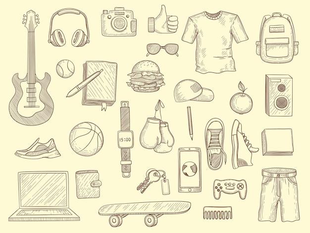 Nastoletnie rzeczy. młodzi chłopcy i dziewczęta ubrania i gadżety nastoletnia nowoczesna garderoba narysowana kolekcja.