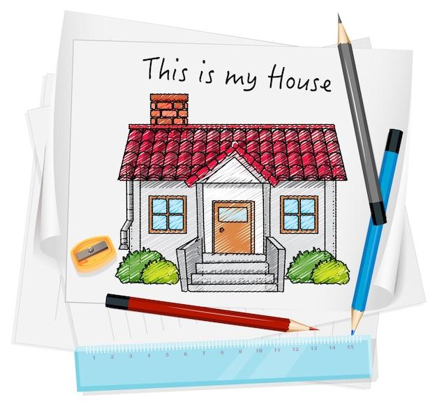 Naszkicuj mały dom na papierze na białym tle