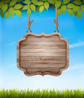 Naturalne tło z liśćmi i drewnianym znakiem.