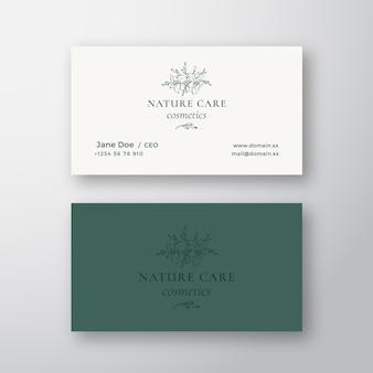 Nature care kosmetyki wektor znak lub logo i szablon wizytówki.