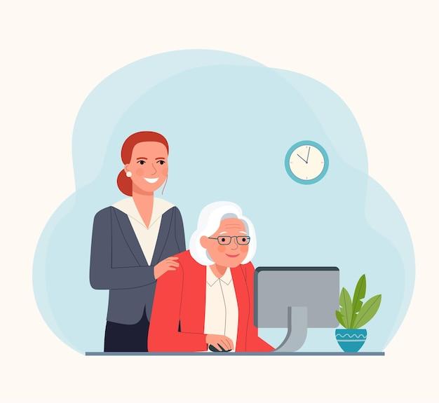 Nauczanie starszej osoby na komputerze.