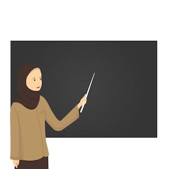 Nauczyciel hidżabu wskazuje tablicę w klasie