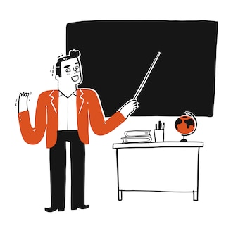 Nauczyciel naucza na czarnej tablicy.