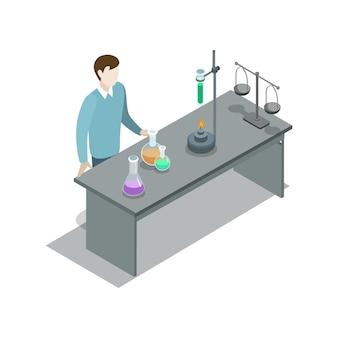 Nauczyciel w pobliżu stołu z wyposażeniem laboratorium