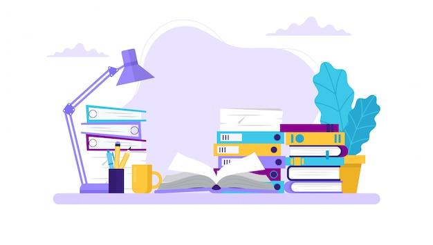 Nauka, stół z książkami i różne foldery.