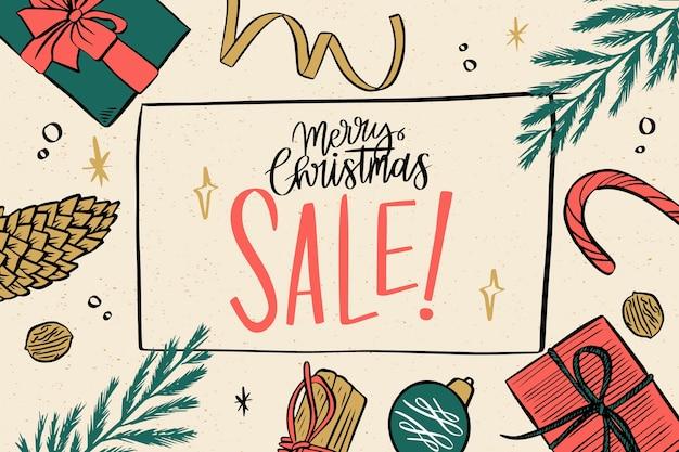 Nd rysowane świąteczna wyprzedaż z liśćmi sosny i prezentami
