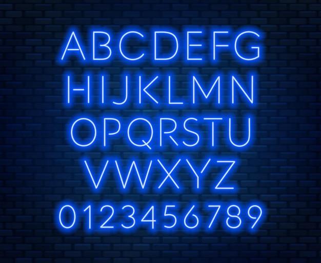 Neon niebieski alfabet na ścianie z cegły