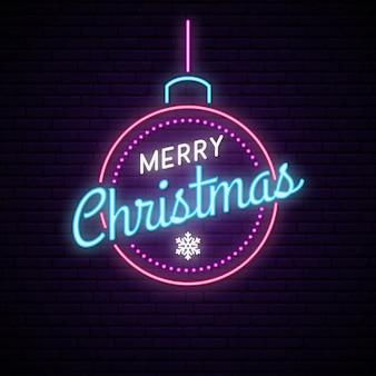 Neonowa piłka z napisem wesołych świąt.