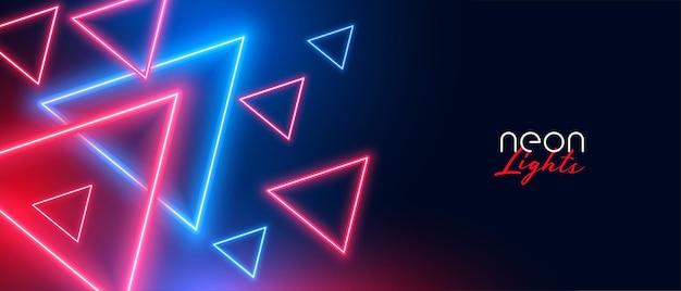 Neonowe trójkątne kształty w kolorze czerwonym i niebieskim