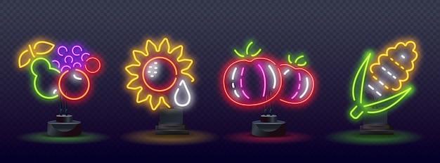 Neonowe warzywa owoce znaki na białym tle na mur z cegły.