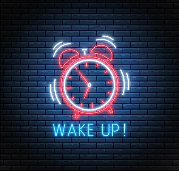 Neonowy budzik. dzwoni zegar. obudź się w tle. zegar ledowy na ścianie z cegły.
