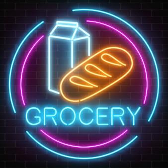 Neonowy sklep spożywczy jarzy się znaka na ściana z cegieł tle. szyld sklepu spożywczego z chlebem i mlekiem w ramce koła.