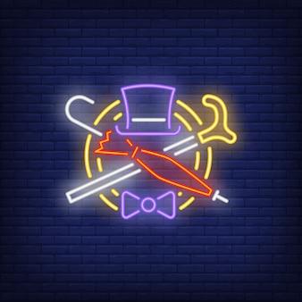 Neonowy znak kapelusz, trzciny, parasol i muszka